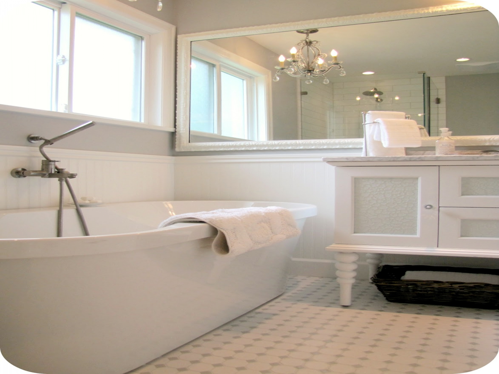 ceramic-flooring-tile-white-standalone-bathtub-glass-window-panel-mirror-with-wooden-frame-small-real-wood-vanity-new-construction-farmhouse-with-bathroom-chandeliers