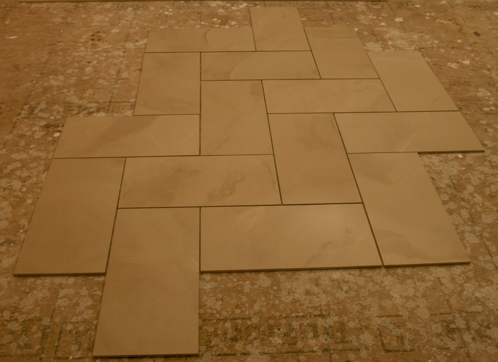 laying a tile floor in a bathroom wood floors