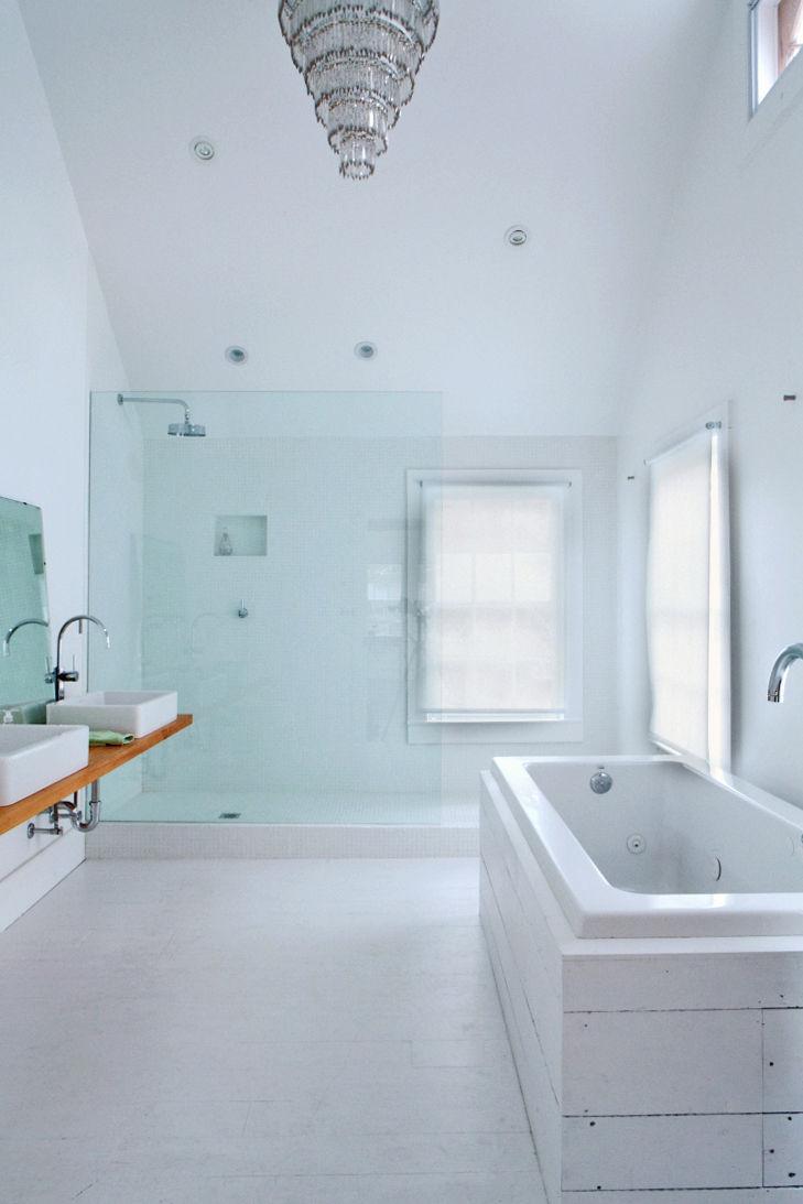 floating_farmhouse_master_bathroom_glass_chandelier_bathtub