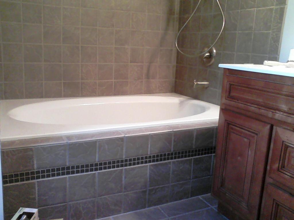 interior-bathroom-simple-yet-stunning-bathroom-design-ideas-with-light-brown-tile-bathtub-cabinet-including-mellowed-light-single-bathroom-vanity-and-rectangular-white-bathtub-good-looking-bathroom-d