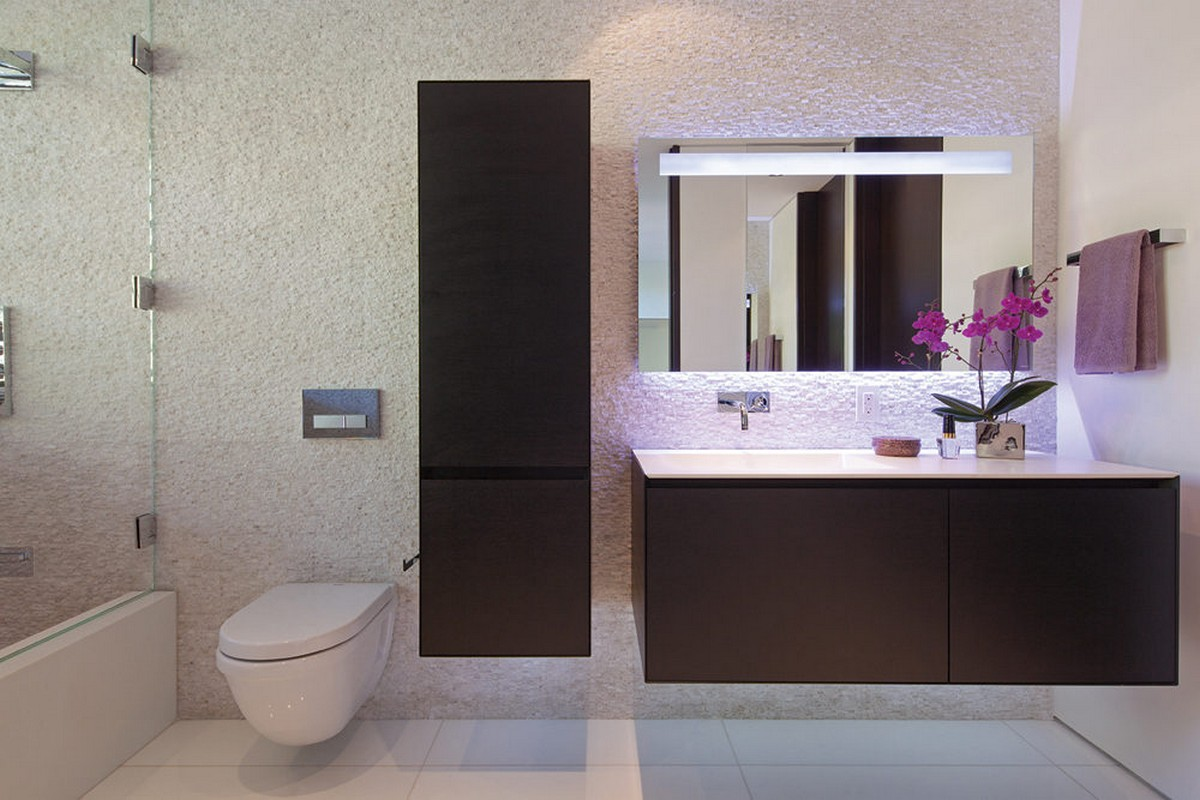 luxury-bathroom-design-with-white-wall-hung-toilet-and-modern-vanity-cabinets-also-textured-wall-and-white-ceramic-tile-floor
