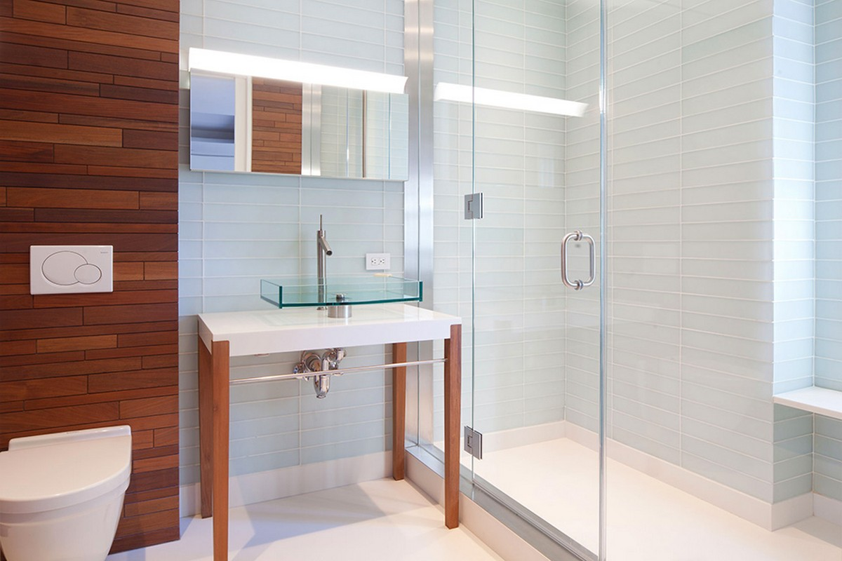modern-luxury-bathroom-with-white-wall-hung-toilets-and-glass-sink-white-vanity-wooden-stands-also-glass-shower-stalls-and-brown-tile-design-ideas