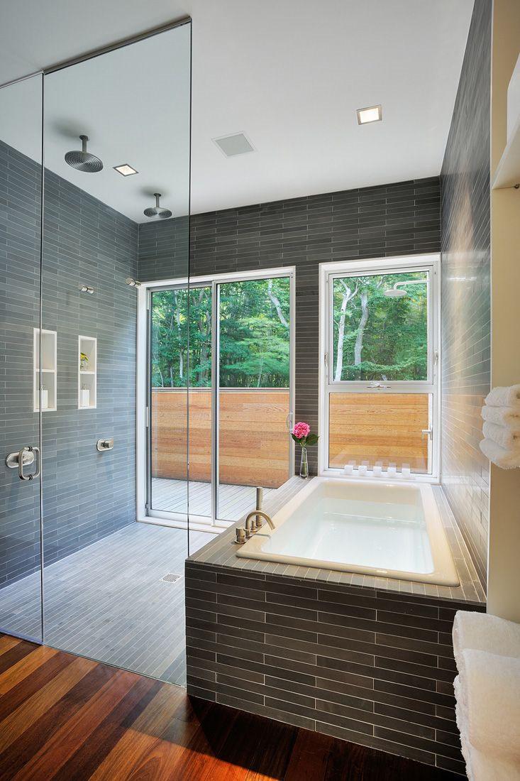 modern-minimalist-bathroom-shower-combo-design-ideas-linear-rectangular-bath-wall-and-floor-tiles-rectangle-white-bathtub-ceiling-mounted-round-chrome-rain-showers-wall-built-in-soaps-storage-shelves
