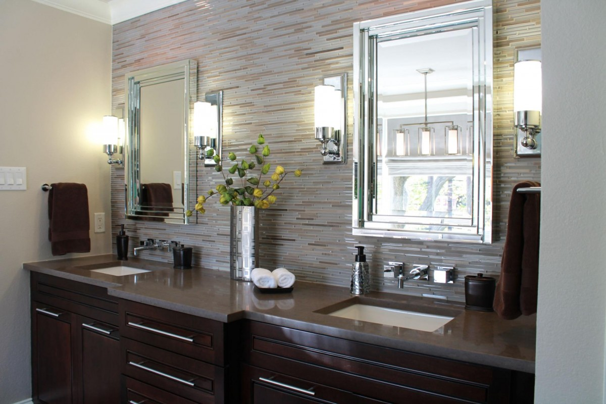 natural-stone-bathroom-wall-tile-mirror-with-glasses-frame-dark-brown-real-wood-vanity-with-storage-drawers-mounted-washbasin-bathroom-sconces-lighting-fixtures-1200x800