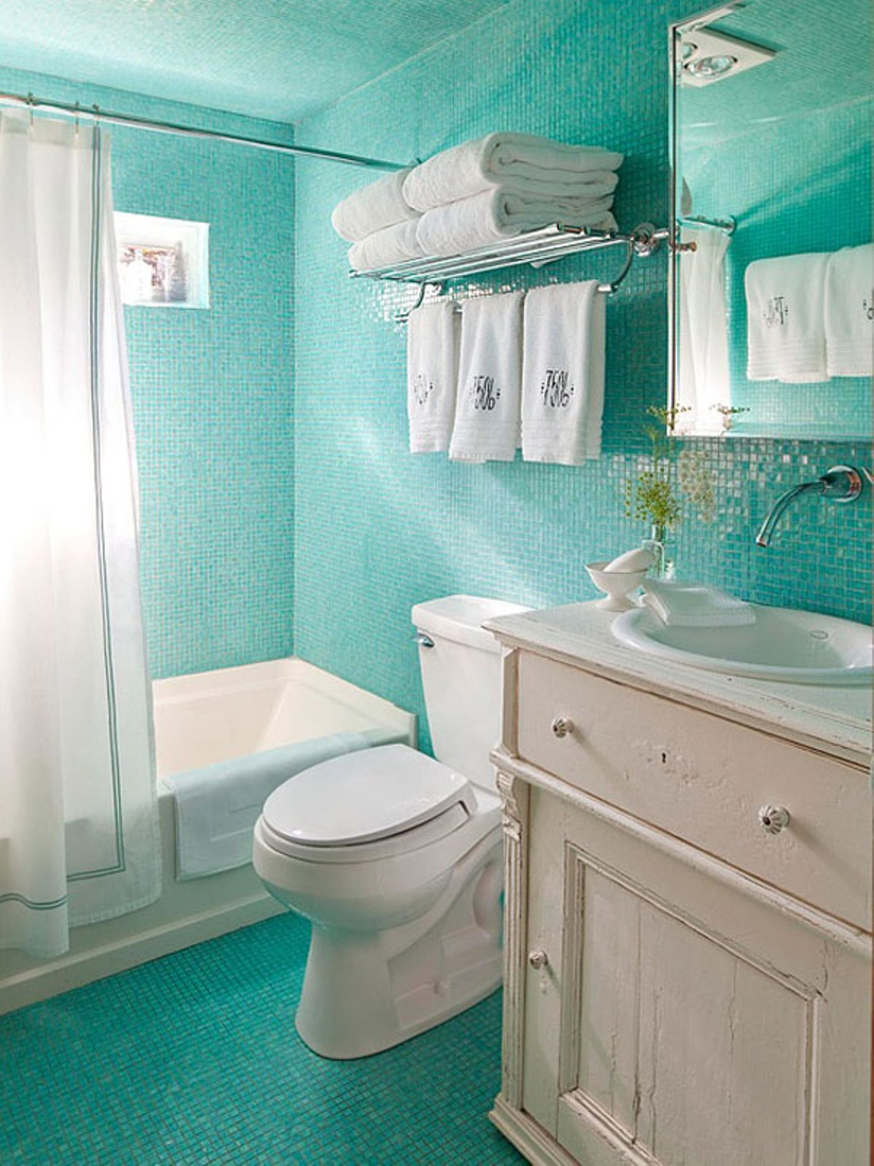 ocean-blue-glass-tile-with-wall-mounted-faucet-and-white-bath-tub-in-small-bathroom-design