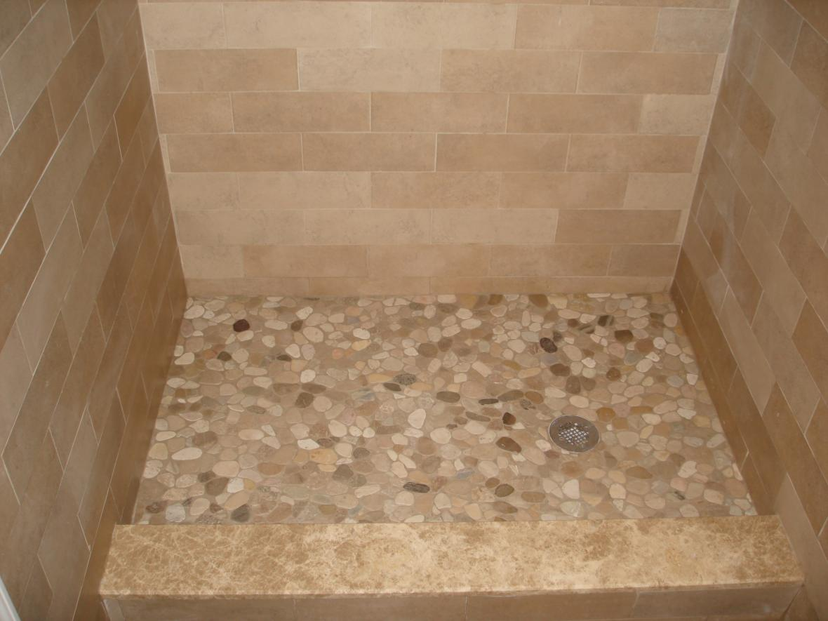 porcelain-tile-shower-with-multiple-patterns-river-stone-shower-floor