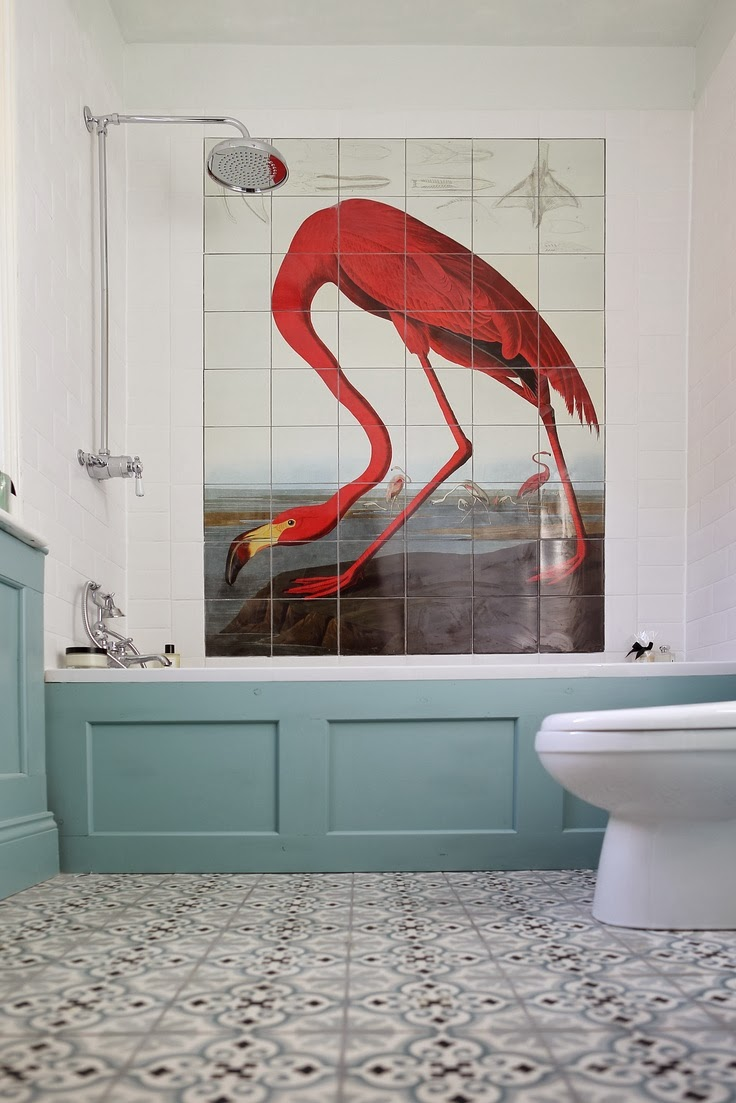 red flamingo wall tiles in white bathroom with blue wanescotting and decorative floor tiles