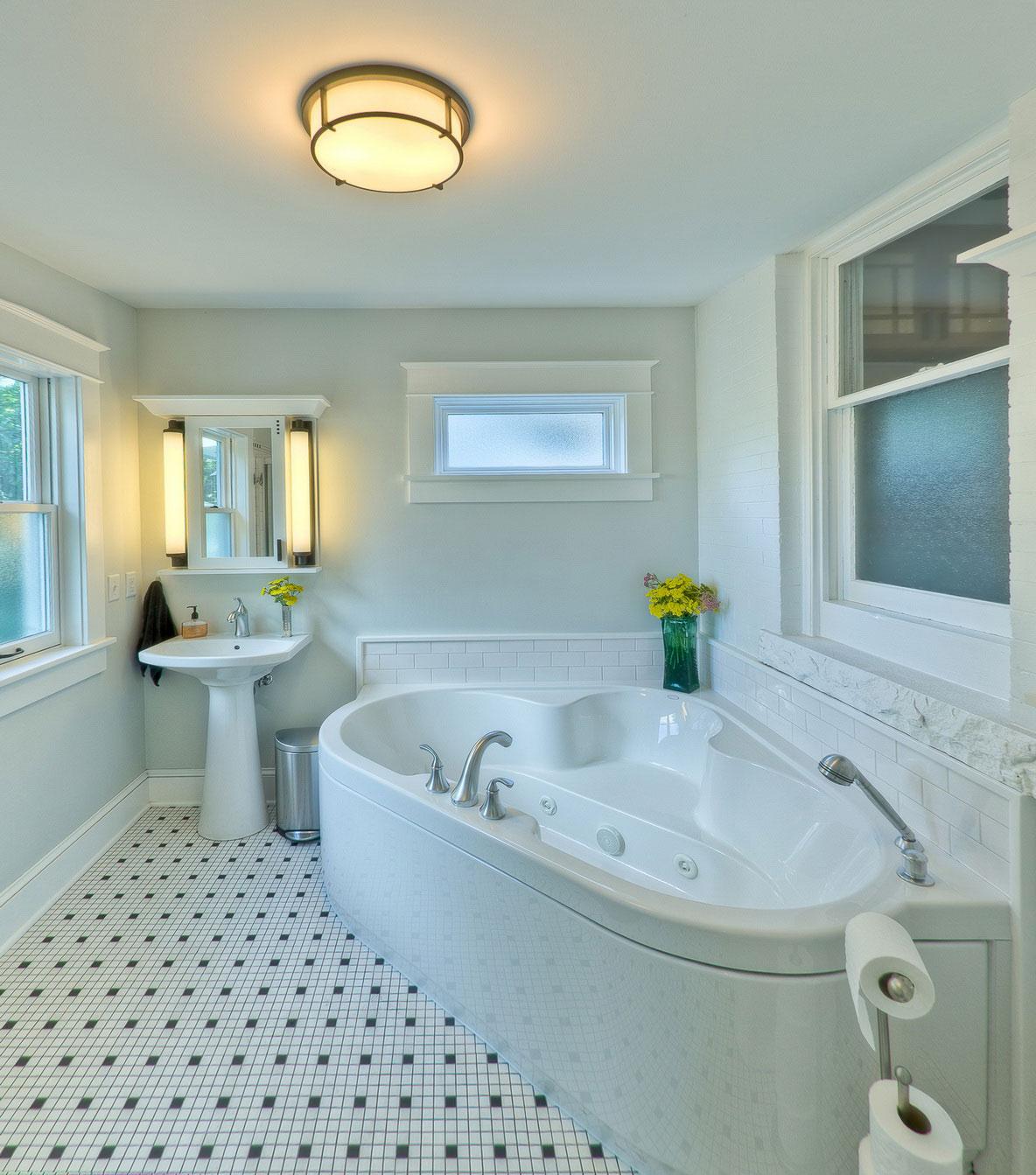 elegance-minimalist-Luxury-bathroom-design-ideas-corner-oval-white-sauna-whirlpool-bathtub-white-acrylic-pedestal-sink-white-wooden-frame-mirrored-front-medicine-cabinet-cylindrical-wall