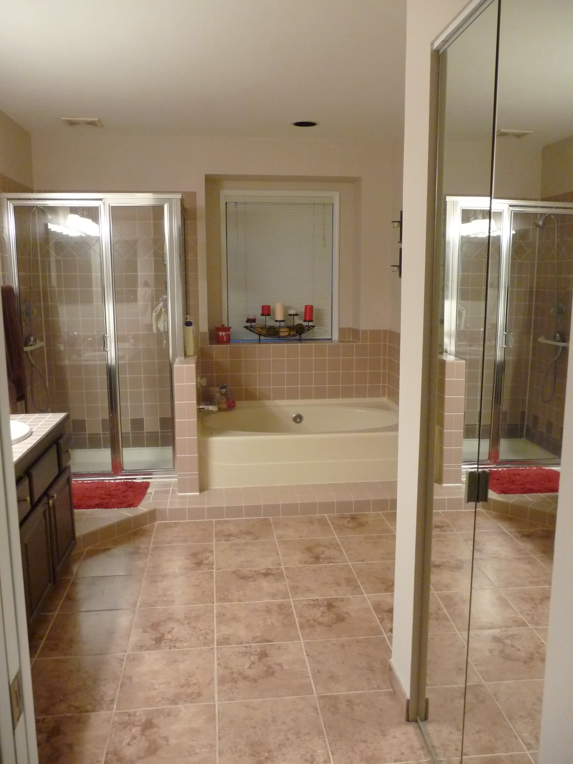 interior-soft-brown-bathroom-tile-floor-connected-by-cream-bathtub-next-to-glass-shower-stalls-elegant-brown-bathroom-tiles-offers-pleasing-nuance-for-your-bathroom