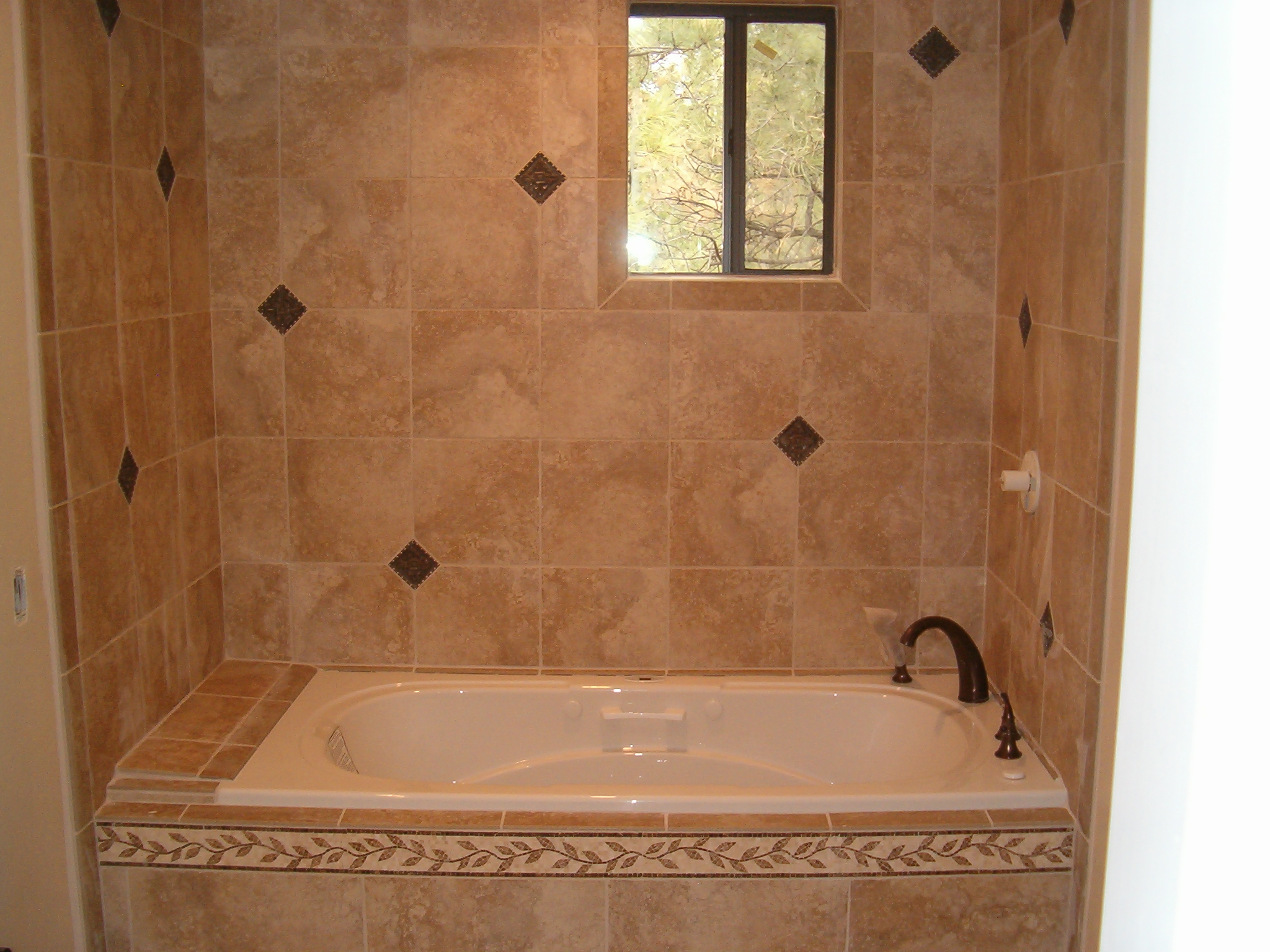 tiling-a-bathroom-wall-on-bathroom-tub-diamond-tile-wall