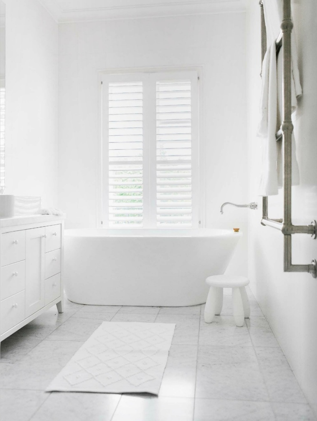 white-bathroom-paint-colors-ideas-for-cottage-style-bathroom-with-free-standing-bath-and-concret-floor-and-white-shutter